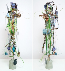 Fret-foil-dangle-glow, 2014, Unique collage with pigment prints, wooden dowel, plastic netting, and ceramic jug, 42 x 18 x 17 inches